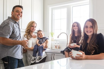 Parents Daniel and Laura with children Luca, Liliana and Sabrina Gennuso are all smiles in the family kitchen. For the past two years the family has displayed remarkable resilience on the road to Luca's recovery