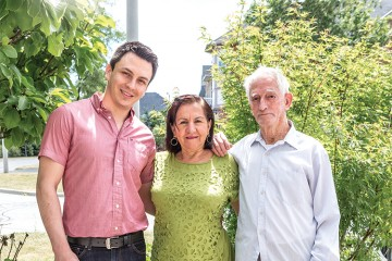 From left to right, Juan Carlos with his mother, Melva, and father, Bravlio
