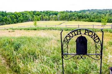The sign at South Pond Farms overlooks its sprawling fields and hills